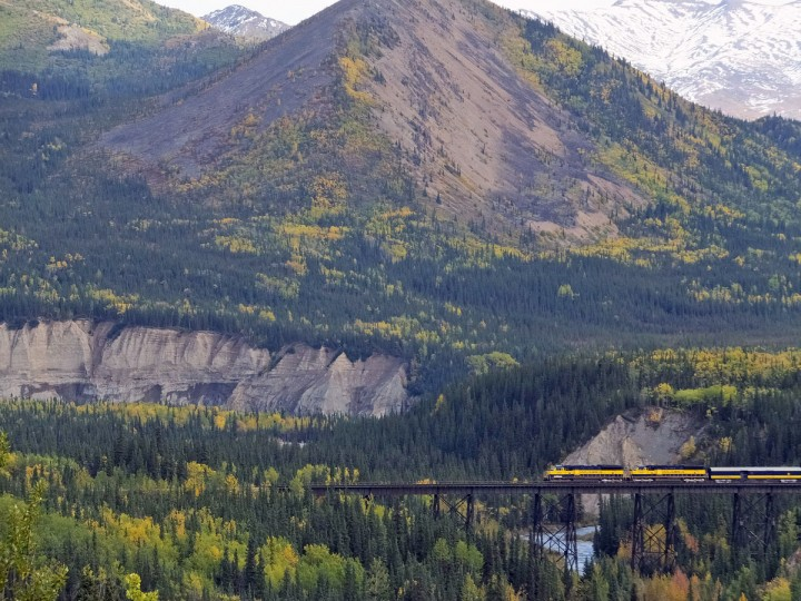 An Alaska Railroad train travels along one of its routes, Thursday, Sept. 3, 2015, in Denali National Park and Preserve, Alaska. The park, home to North America's tallest peak, the newly minted Denali, covers more than 6 million acres, or about the size of Vermont. (AP Photo/Becky Bohrer)