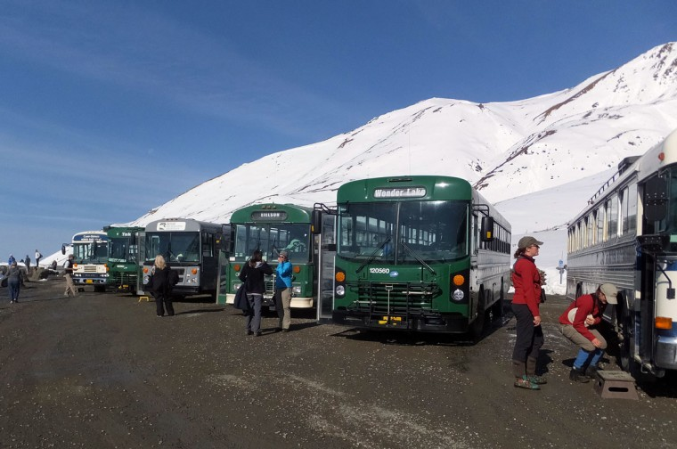 Buses are parked at Eielson Visitor Center, on Wednesday, Sept. 2, 2015, in Denali National Park and Preserve, Alaska. The summer travel season is winding down at Denali National Park and Preserve, a time of year that sees the vast majority of visitors to this largely wild place. (AP Photo/Becky Bohrer)