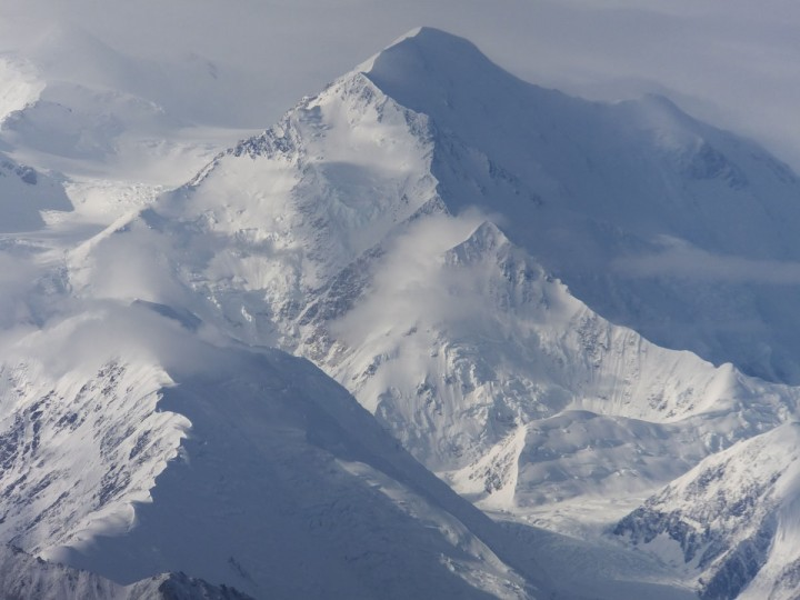 This Aug. 27, 2014 file photo, clearer skies provided this view of one of the faces of North America's tallest peak, Mount McKinley in Denali National Park and Preserve, Alaska. North America's tallest mountain will again be known by its Alaska Native name. President Barack Obama announced Sunday his administration will change the name of Mount McKinley to Denali to honor Athabascans, central Alaska Indians whose territory stretches 500 miles, from the Brooks Range south to Cook Inlet. (AP Photo/Becky Bohrer,File)