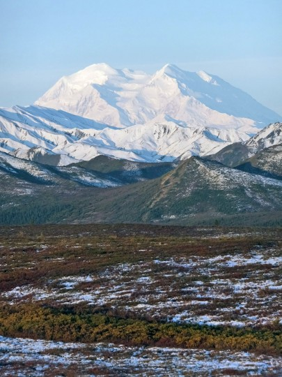 North America's tallest peak, the newly minted Denali, looms over the landscape, Wednesday, Sept. 2, 2015, in Denali National Park and Preserve, Alaska. In late August, on the eve of a visit by President Barack Obama to Alaska, the White House announced the name of the mountain would be changed from Mount McKinley to Denali, a nod to the Athabascan name for the peak. (AP Photo/Becky Bohrer)