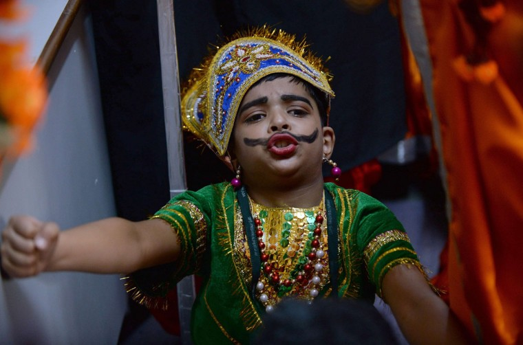 An Indian schoolboy rehearses prior to performing in a Janmashtami play at Delhi Public School in Ghaziabad, some 20 kms east of New Delhi on September 1, 2015. Janmashtami, which takes place this year on September 5, is an annual celebration of the birth of the Hindu deity Krishna. (PRAKASH SINGH/AFP/Getty Images)