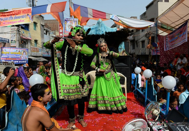 Indian Hindus dressed as the Hindu God Lord Krishna and his consort Radha take part in a procession on the eve of 'Janmashtami', which marks Krishna's birth, in the old quarters of New Delhi on September 3, 2015. (SAJJAD HUSSAIN/AFP/Getty Images)