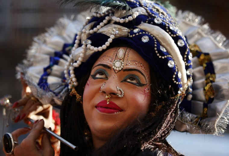 An Indian devotee dressed as Hindu god Krishna attends a procession on the eve of Janmashtami in Jammu, India, Friday, Sep. 4, 2015. Janmashtami is the festival that marks the birth of Krishna. (AP Photo/Channi Anand)