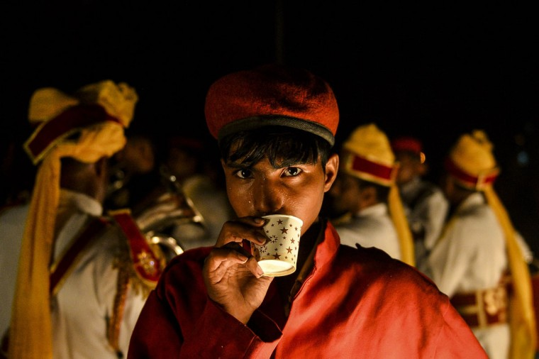 A member of an Indian wedding band drinks tea during a Janmashtami procession in New Delhi on September 1, 2015. Janmashtami, which takes place this year on September 5, is an annual celebration of the birth of the Hindu deity Krishna. (Chandan Khanna/AFP/Getty Images)