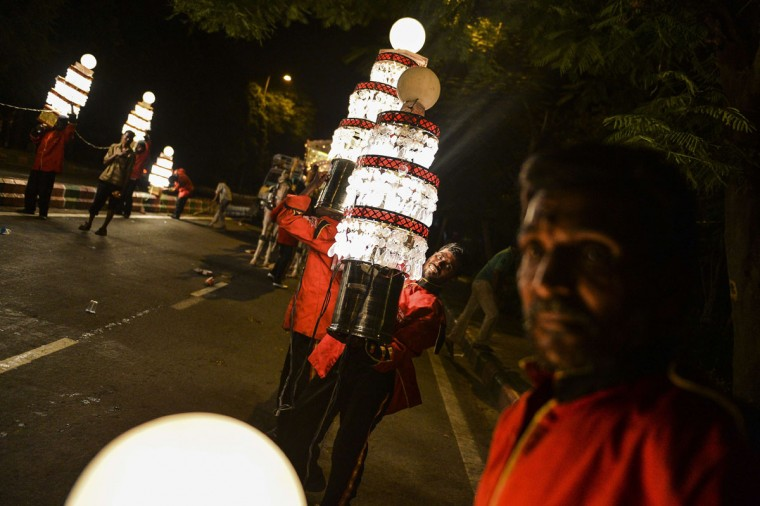 A member of an Indian wedding band lifts a lantern during a procession marking the Hindu festival of Janmashtami, in New Delhi on September 1, 2015. Janmashtami, which takes place this year on September 5, is an annual celebration of the birth of the Hindu deity Krishna. (Chandan Khanna/AFP/Getty Images)