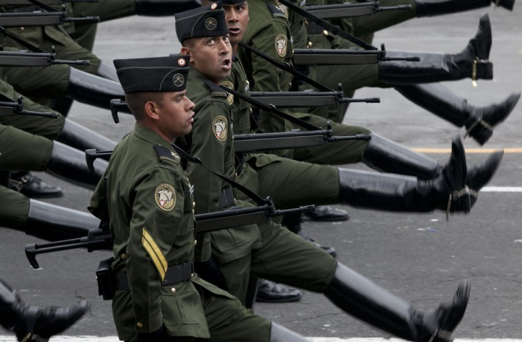 Soldiers march during the Independence Day military parade in the capital's main plaza, the Zocalo, in Mexico City, Wednesday, Sept. 16, 2015. Mexico celebrates the anniversary of its 1810 independence uprising. (AP Photo/Marco Ugarte)