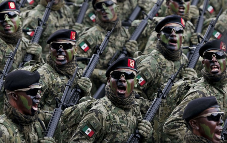 Soldiers shout and march during the Independence Day military parade in the capital's main plaza, the Zocalo, in Mexico City, Wednesday, Sept. 16, 2015. Mexico celebrates the anniversary of its 1810 independence uprising. (AP Photo/Marco Ugarte)