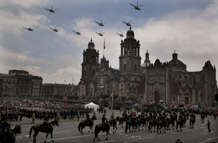 Soldiers ride on horseback during the Independence Day military parade in the capital's main plaza, the Zocalo, where the Cathedral is located in Mexico City, Wednesday, Sept. 16, 2015. Mexico celebrates the anniversary of its 1810 independence uprising. (AP Photo/Marco Ugarte)