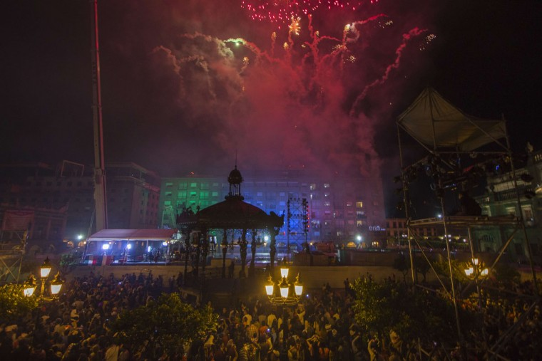 People watch fireworks and light shows during the 205th Mexico Independence Day celebrations at the Armas Square in Guadalajara City on September 15, 2015. (HECTOR GUERRERO/AFP/Getty Images)