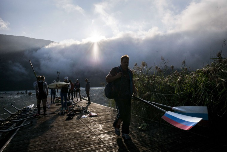 Rowers carry their boat and oars, on September 4, 2015 in Aiguebelette-Le-Lac, during the 2015 World Rowing Championships. (JEFF PACHOUD/AFP/Getty Images)