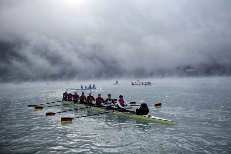 Rowers warm up in the fog in the early morning during the World rowing championships in Aiguebelette, French Alps, Friday, Sept. 4, 2015. (AP Photo/Laurent Cipriani)