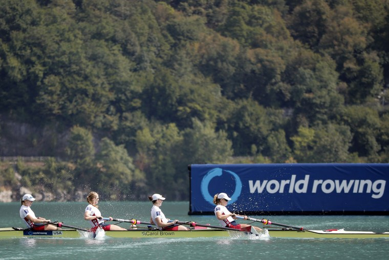 From left, USA's Kristine O'Brien, Grace Latze, Adrienne Martelli and Grace Luczak speed as they cross the finish line to win the Women's four during the World rowing championships in Aiguebelette, French Alps, Friday, Sept. 4, 2015. (AP Photo/Laurent Cipriani)