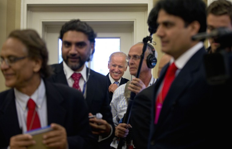 Vice President Joe Biden, center, smiles as watches from the back of the Oval Office of the White House in Washington, Thursday, Oct. 22, 2015, during a meeting between President Barack Obama and Pakistani Prime Minister Nawaz Sharif. On Wednesday, Biden announced that he would not run for the presidential nomination. (AP Photo/Pablo Martinez Monsivais)