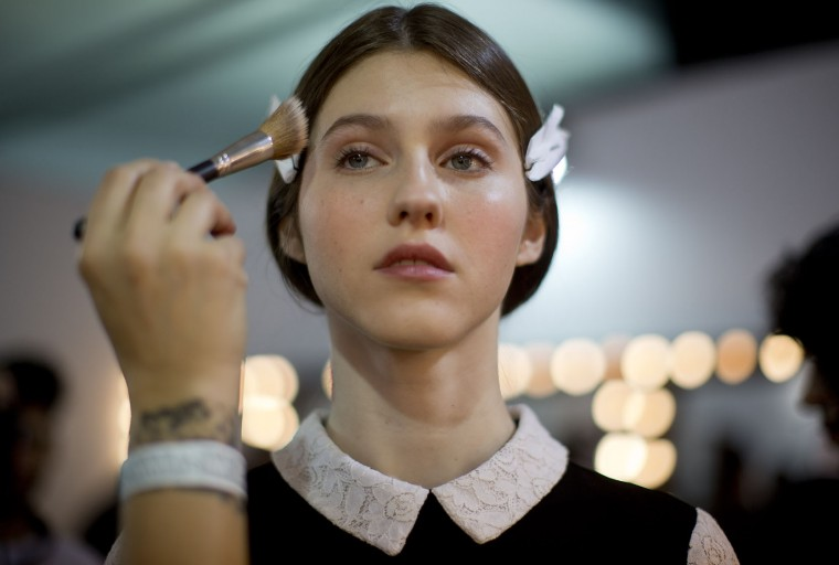 A model has her makeup done backstage before the start of the Gloria Coelho winter 2016 collection during Sao Paulo Fashion Week in Sao Paulo, Brazil, Thursday, Oct. 22, 2015. (AP Photo/Andre Penner)