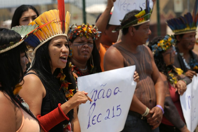 Karaja indigenous woman Narube Werreria protests the World Indigenous Games outside the arena in Palmas, Brazil, Thursday, Oct. 22, 2015. Protesters denounced what they said was poor organization and unnecessary multi-million dollar spending on the games, saying the money would be better spent on improving the conditions of Brazil's impoverished indigenous peoples. (AP Photo/Eraldo Peres)