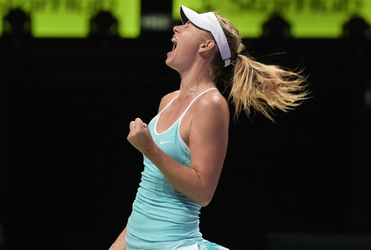 Maria Sharapova of Russia shouts after she wins a point against Agnieszka Radwanska of Poland during their singles match at the WTA tennis finals in Singapore on Sunday, Oct. 25, 2015. (AP Photo/Joseph Nair)