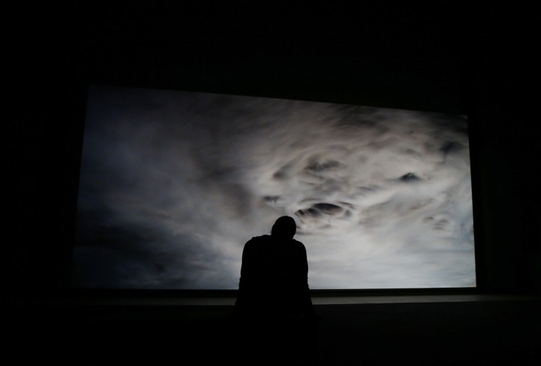 A man watches an installation by artist Philippe Parreno, part of the 'Hypothesis' exhibition, on display at the Hangar Bicocca in Milan, Italy, Thursday, Oct. 29, 2015. (AP Photo/Luca Bruno)