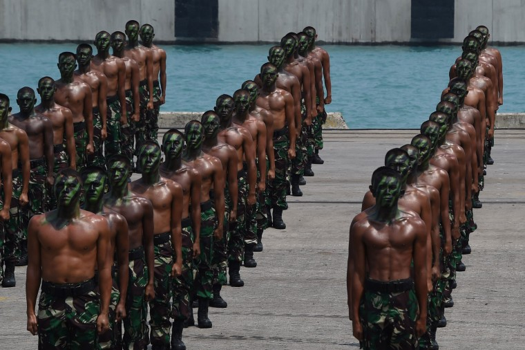 Indonesian military troops prepare for a demonstration during an exercise at a naval base in Cilegon, West Java province on October 3, 2015 in preparation for the 70th anniversary celebration of the Indonesian Armed Forces on October 5 to be led by Indonesian President Joko Widodo. (Romeo Gacad/AFP Getty Images)