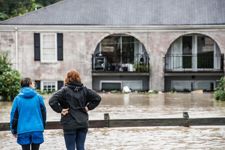 People look out over damage caused by flood water October 4, 2015 in Columbia, South Carolina. (Photo by Sean Rayford/Getty Images)