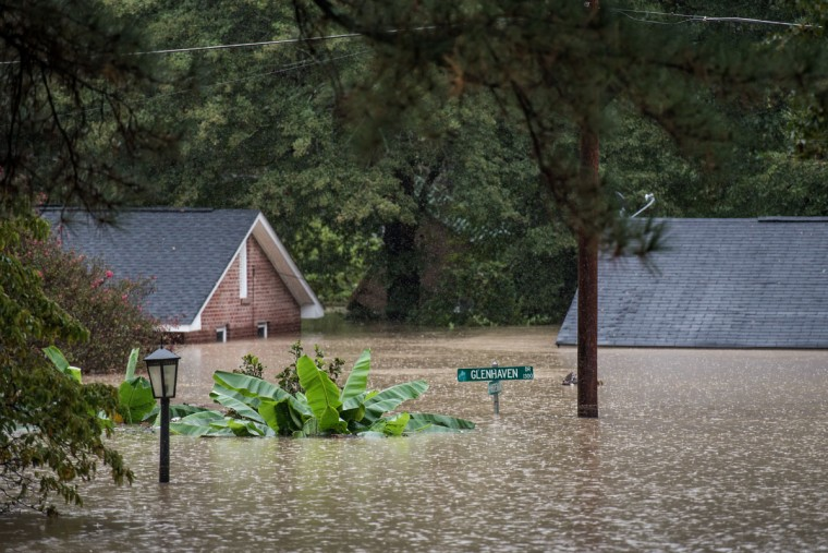 Homes are inundated by flood waters October 4, 2015 in Columbia, South Carolina. (Photo by Sean Rayford/Getty Images)