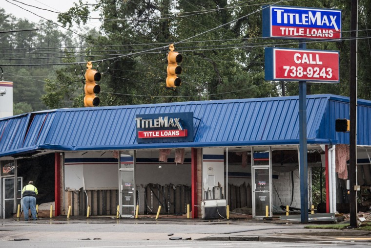 A TitleMax store shows damage from yesterday's flood waters on Garners Ferry Road following flooding in the area October 5, 2015 in Columbia, South Carolina. (Photo by Sean Rayford/Getty Images)