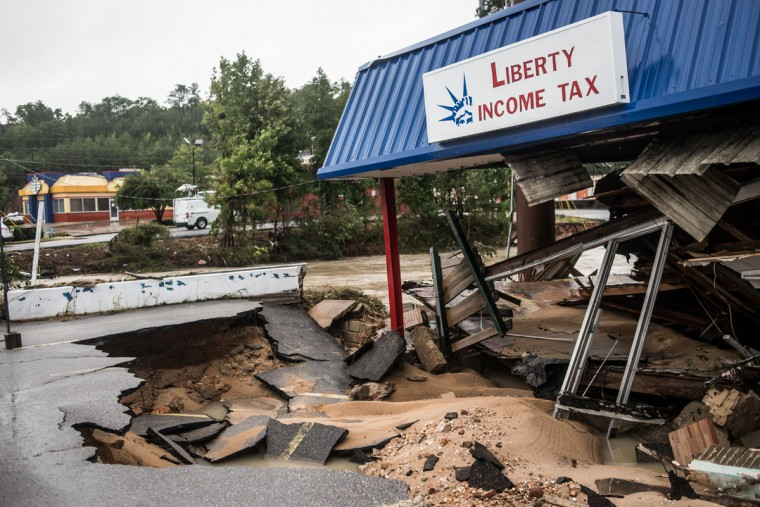 A Liberty Income Tax store shows damage from yesterday's flood waters on Garners Ferry Road following flooding in the area October 5, 2015 in Columbia, South Carolina. (Photo by Sean Rayford/Getty Images)