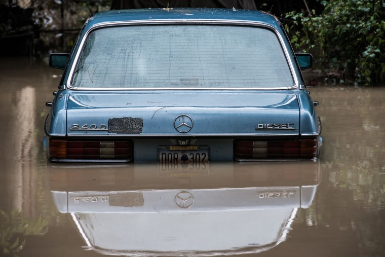 A Mercedes Benz is surrounded by flood waters following flooding in the area October 5, 2015 in Columbia, South Carolina. The state of South Carolina experienced record rainfall amounts over the weekend, which stranded motorists and residents and forced hundreds of evacuations and rescues. (Photo by Sean Rayford/Getty Images)