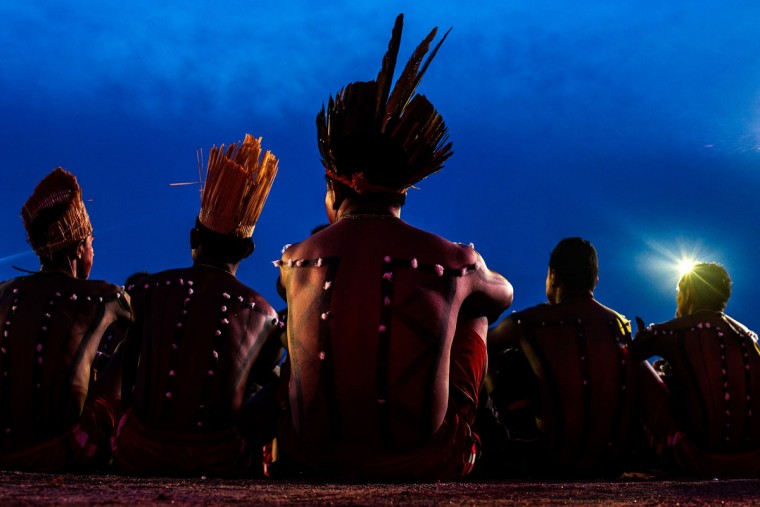 Indigenous men from the Xerente tribe watch the competition during the first World Games for Indigenous Peoples on October 27, 2015 in Palmas, Brazil. (Photo by Buda Mendes/Getty Images)