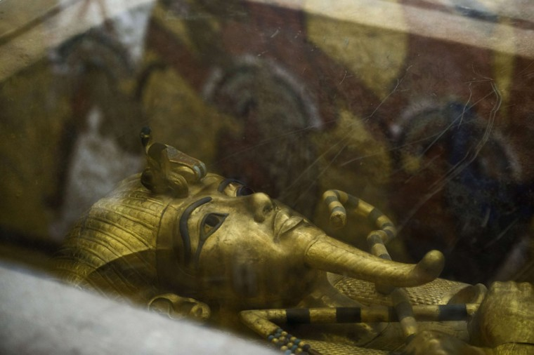 A picture taken on September 28, 2015 shows the golden sarcophagus of King Tutankhamun in his burial chamber in the Valley of the Kings, close to Luxor, 500 kms south of Cairo. British Egyptologist Nicholas Reeves, who believes the legendary Queen Nefertiti may be buried in a secret room adjoining Tutankhamun's tomb arrived in Egypt to test his theory. To this day, Nefertiti's final resting place remains a mystery. (KHALED DESOUKI/AFP/Getty Images)