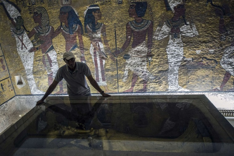 An Egyptian archaeologist looks at the sarcophagus of King Tutankhamun in his burial chamber in the Valley of the Kings, close to Luxor, 500 kms south of Cairo on September 28, 2015. British Egyptologist Nicholas Reeves, who believes the legendary Queen Nefertiti may be buried in a secret room adjoining Tutankhamun's tomb arrived in Egypt to test his theory. To this day, Nefertiti's final resting place remains a mystery. (KHALED DESOUKI/AFP/Getty Images)