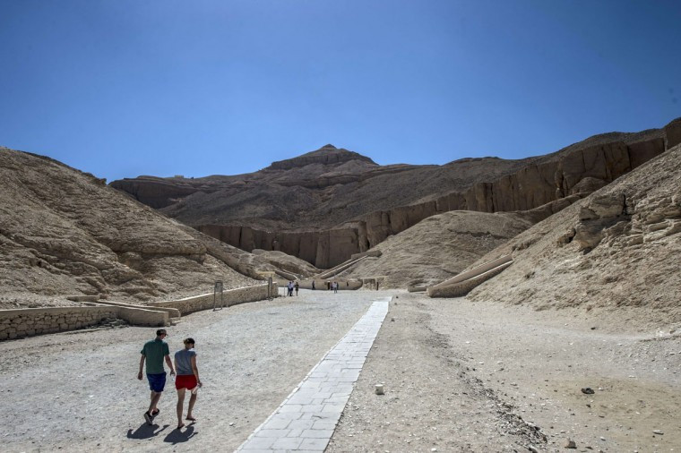 Tourists visit the Valley of the Kings, close to Luxor, 500 kms south of Cairo on September 28, 2015. British Egyptologist Nicholas Reeves, who believes the legendary Queen Nefertiti may be buried in a secret room adjoining King Tutankhamun's tomb arrived in Egypt to test his theory. To this day, Nefertiti's final resting place remains a mystery. (KHALED DESOUKI/AFP/Getty Images)