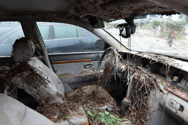 The interior of a flooded car is seen in Columbia, South Carolina on October 5, 2015. Record rainfall left large areas of the US southeast under water Sunday as roads were closed and residents were warned to stay indoors. The states of North and South Carolina have been particularly hard hit by heavy flooding, but the driving rain in recent days has spared almost none of the US East Coast. More than 200 swift-water rescues have been reported in South Carolina since late October 3, while the state's Department of Transportation said at least 211 state roads and 43 bridges were closed due to flooding. (MLADEN ANTONOV/AFP/Getty Images)