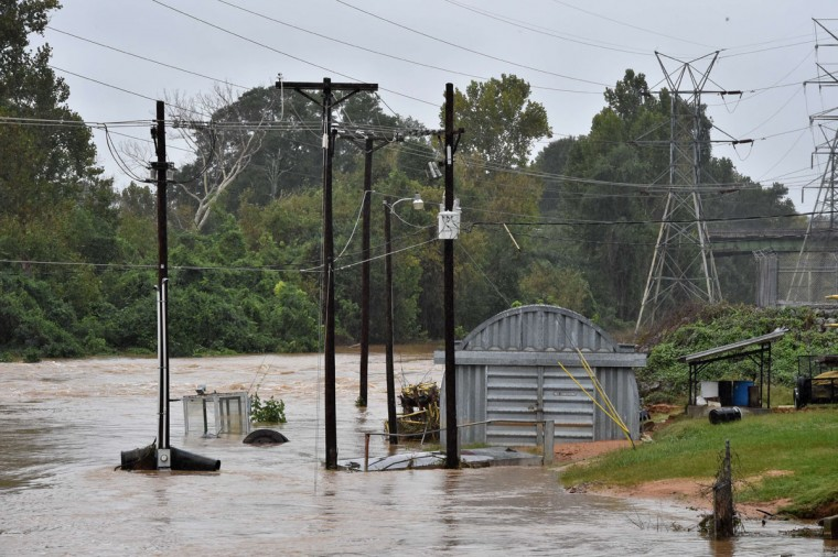 The flood-swollen Congaree River is seen near Columbia, South Carolina on October 5, 2015. Relentless rain left large areas of the US southeast under water. The states of North and South Carolina have been particularly hard hit, but the driving rain in recent days has spared almost none of the US East Coast. (MLADEN ANTONOV/AFP/Getty Images)