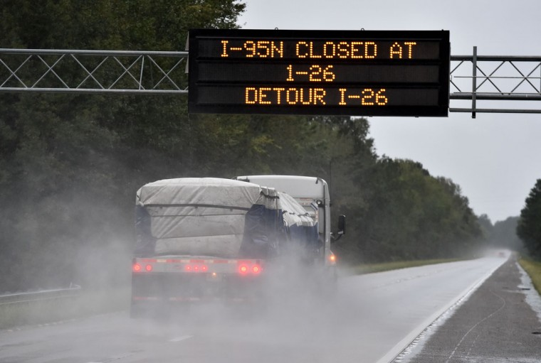 An information alert board announces the closing of Interstate 95 due to the flash floods at the crossing with Interstate 26 in South Carolina on October 5, 2015. Relentless rain left large areas of the US southeast under water. The states of North and South Carolina have been particularly hard hit, but the driving rain in recent days has spared almost none of the US East Coast.(MLADEN ANTONOV/AFP/Getty Images)
