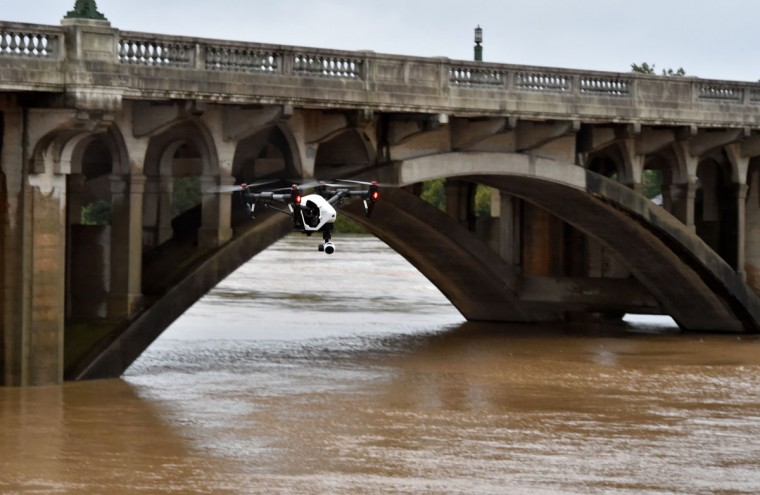 A drone flies over the waters of Congaree River in Columbia in South Carolina on October 5, 2015. Relentless rain left large areas of the US southeast under water. The states of North and South Carolina have been particularly hard hit, but the driving rain in recent days has spared almost none of the US East Coast. (MLADEN ANTONOV/AFP/Getty Images)