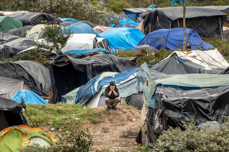 "A picture taken in Calais on October 7, 2015 shows a site dubbed the ""New Jungle,"" where some 3,000 people have set up camp -- most seeking desperately to get to England. (PHILIPPE HUGUEN/AFP/Getty Images)"