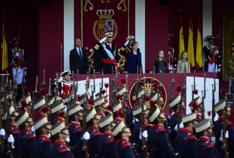 King Felipe VI of Spain, his wife Queen Letizia, Princess Leonor and Princess Sofia attend the Spanish National Day military parade in Madrid on October 12, 2015. (AFP Photo/Pierre-Philippe Marcou)