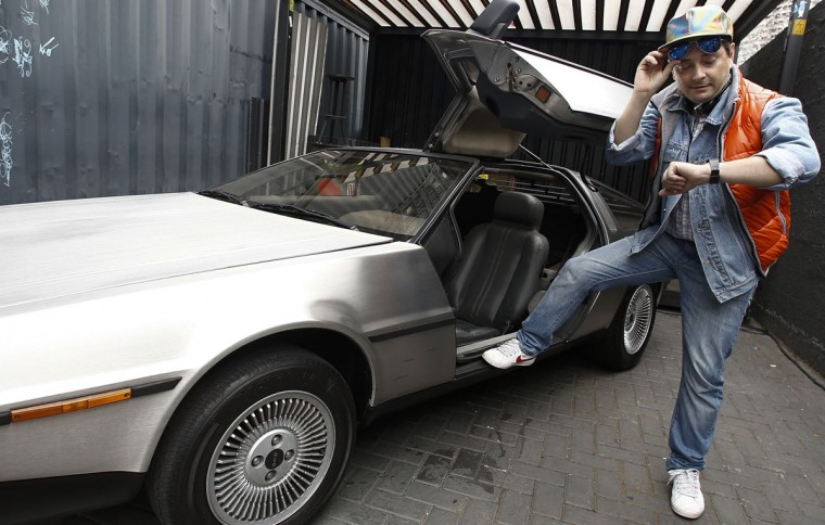 "Characterized man takes part during a celebration event of the 30th anniversary of the movie ""Back to the Future"" in Sao Paulo, Brazil on October 17, 2015. (AFP Photo/Miguel Schincariol)"