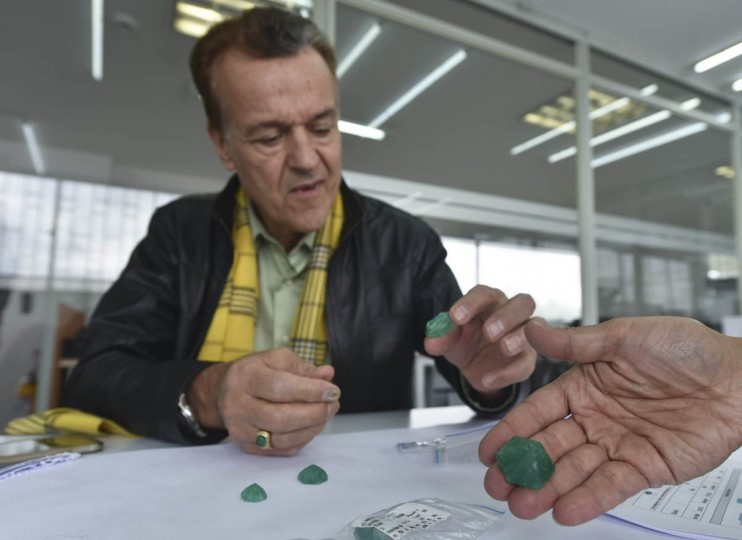 Ronald Ringsrud, director of Emerald Quality of Muzo Emerald Company, speaks as he shows emeralds during an interview in Bogota, on October 16, 2015. (Luis Acosta/Getty Images)