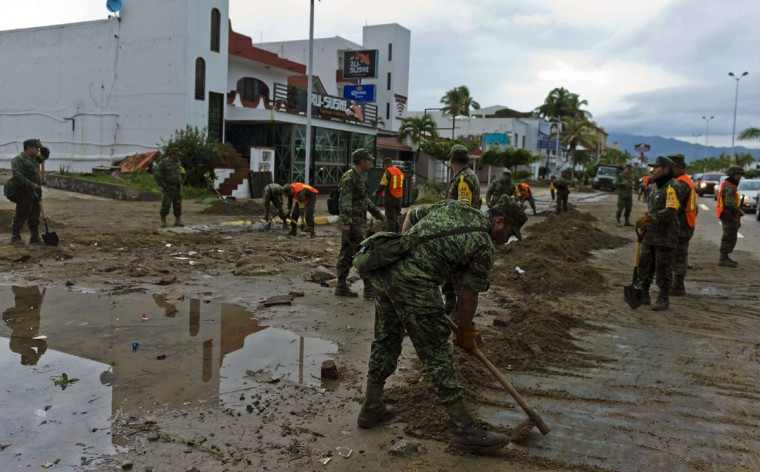 Mexican soldiers remove sand from the street in Manzanillo, state of Colima, after Hurricane Patricia hit the shore of neighbouring Jalisco state, on October 24, 2015. Record-breaking Hurricane Patricia weakened to a tropical storm over north-central Mexico on Saturday, dumping heavy rain that triggered flooding and landslides but so far causing less damage than feared. (OMAR TORRES/AFP/Getty)