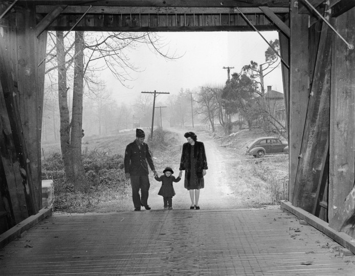1944 - Edward and Jean Corues with their daughter, Doris Jean, 3, walk through one of the few remaining covered bridges near their home. (A. Aubrey Bodine/Baltimore Sun)