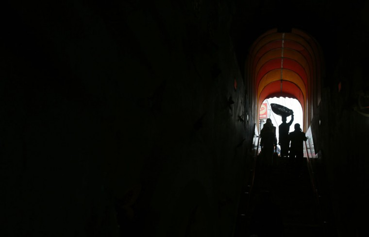 A Bangladeshi laborer carries a basket on his head and enters an underpass in Dhaka, Bangladesh, Thursday, Oct. 1, 2015. Despite the government's banning of several radical Islamic groups, intelligence sources have confirmed that several hard-line groups are active in Bangladesh where almost 90 percent of its 160 million people are Muslim. (AP Photo/ A.M. Ahad)
