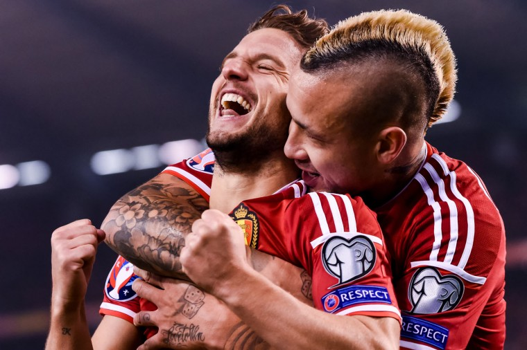 Belgium's Dries Mertens, left, celebrates with teammate Radja Nainggolan after scoring against Israel during a Group B Euro 2016 qualifying soccer match between Belgium and Israel at the King Baudouin stadium in Brussels on Tuesday, Oct. 13, 2015. (AP Photo/Geert Vanden Wijngaert)