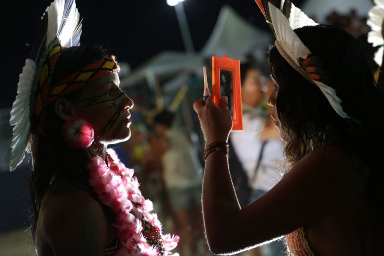 In this photo taken Saturday, Oct. 24, 2015, Brazilian indigenous prepare for a indigenous beauty parade during World Indigenous Games, in Palmas, Brazil. (AP Photo/Eraldo Peres)