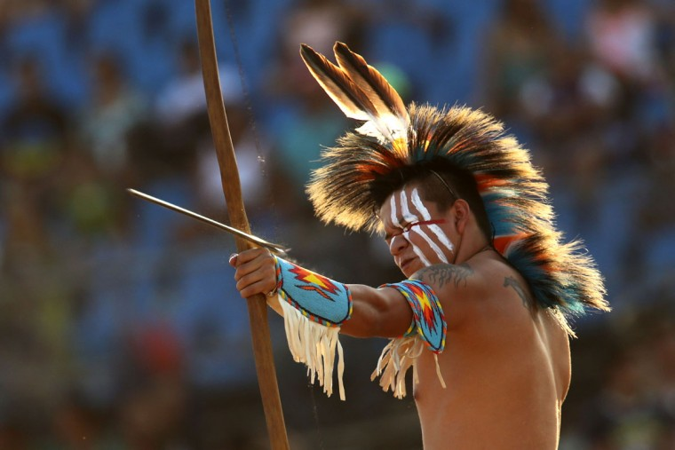 A participant from the United States takes part in the bow and arrow competition at the World Indigenous Games, in Palmas, Brazil, Monday, Oct. 26, 2015. The event, which comes one year after Brazil played host to soccer's World Cup and ahead of next year's Olympics in Rio de Janeiro, kicked off on Friday. (AP Photo/Eraldo Peres)