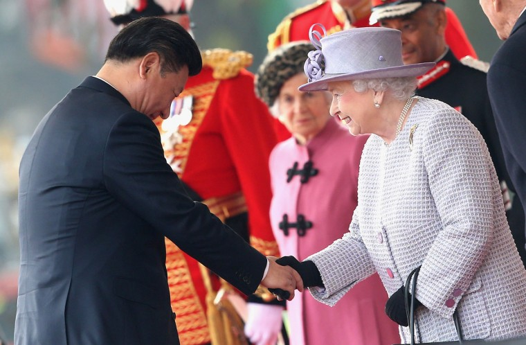 Britain's Queen Elizabeth II , right, greets Chinese President Xi Jinping, during the official ceremonial welcome for the Chinese State Visit, in London, Tuesday, Oct. 20, 2015. Chinese President Xi Jinping prepared to address Britain's Parliament and dine with Queen Elizabeth II Tuesday as he began a state visit that is intended to cement close economic ties between the two countries — but risks being overshadowed by concerns over Beijing's growing economic clout in Britain. (Chris Jackson/Pool Photo via AP)