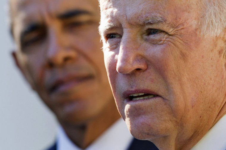 President Barack Obama listens as Vice President Joe Biden speaks in the Rose Garden of the White House in Washington, Wednesday, Oct. 21, 2015, to announce that he will not run for the presidential nomination. (AP Photo/Jacquelyn Martin)