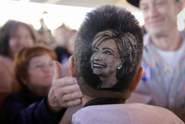Mariz Anita Monsivaiz shows off the likeness of Democratic presidential candidate Hillary Rodham Clinton shaved on her head during a campaign event where Clinton spoke,, Thursday, Oct. 15, 2015, in San Antonio. (AP Photo/Eric Gay)