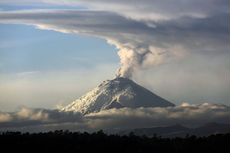 A large plume of ash and steam rises from the Cotopaxi volcano as seen from Quito, Ecuador, Thursday, Oct. 8, 2015. The Geophysics Institute said during the first week of October the Cotopaxi has shown an increase in emission of ash and temperature, and a noted glow in the crater. (AP Photo/Dolores Ochoa)