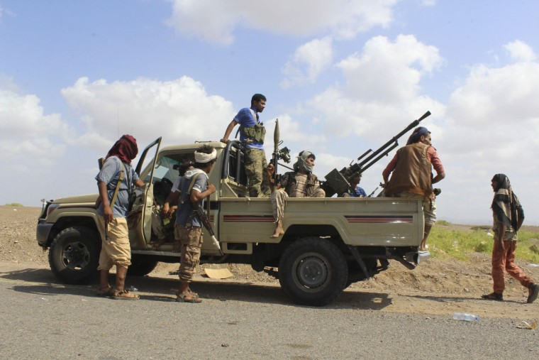 Fighters against Shiite rebels known as Houthis gather on a road leading to the strategic Strait of Bab al-Mandab off Aden, Yemen, Thursday, Oct. 1, 2015. Military and security officials said fierce battles are ongoing between military units loyal to Yemeni President Abed Rabbo Mansour Hadi and pro-Hadi fighters against Shiite Houthi rebels and allied military units in Bab al-Mandab, the strategic southern entrance to the Red Sea. (AP Photo/Wael Qubady)